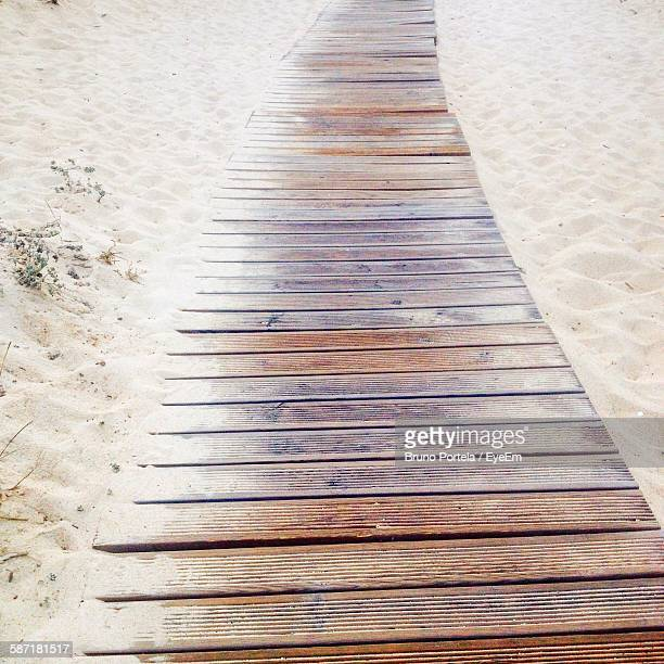 High Angle View Of Boardwalk At Sandy Beach