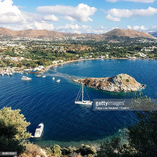 High Angle View Of Boat Moving On Sea Against Mountain
