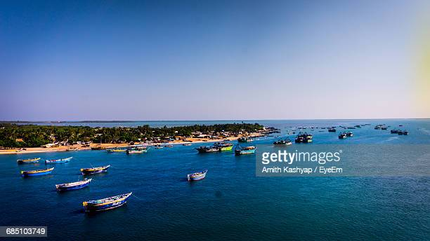 High Angle View Of Boats In Sea Against Clear Blue Sky