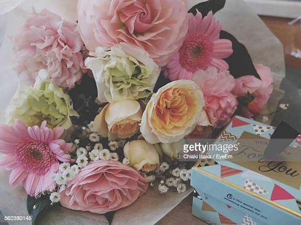 High Angle View Of Bouquet And Gift Box