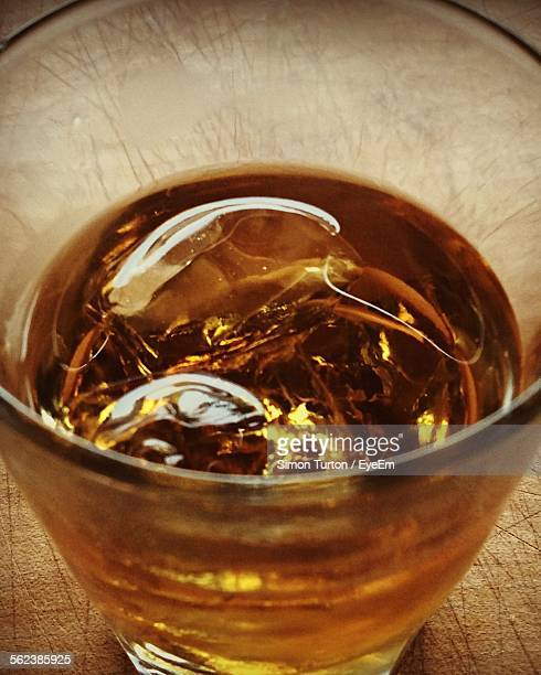 High Angle View Of Bourbon Whiskey In Glass On Table