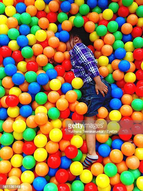 High Angle View Of Boy Playing In Ball Pit