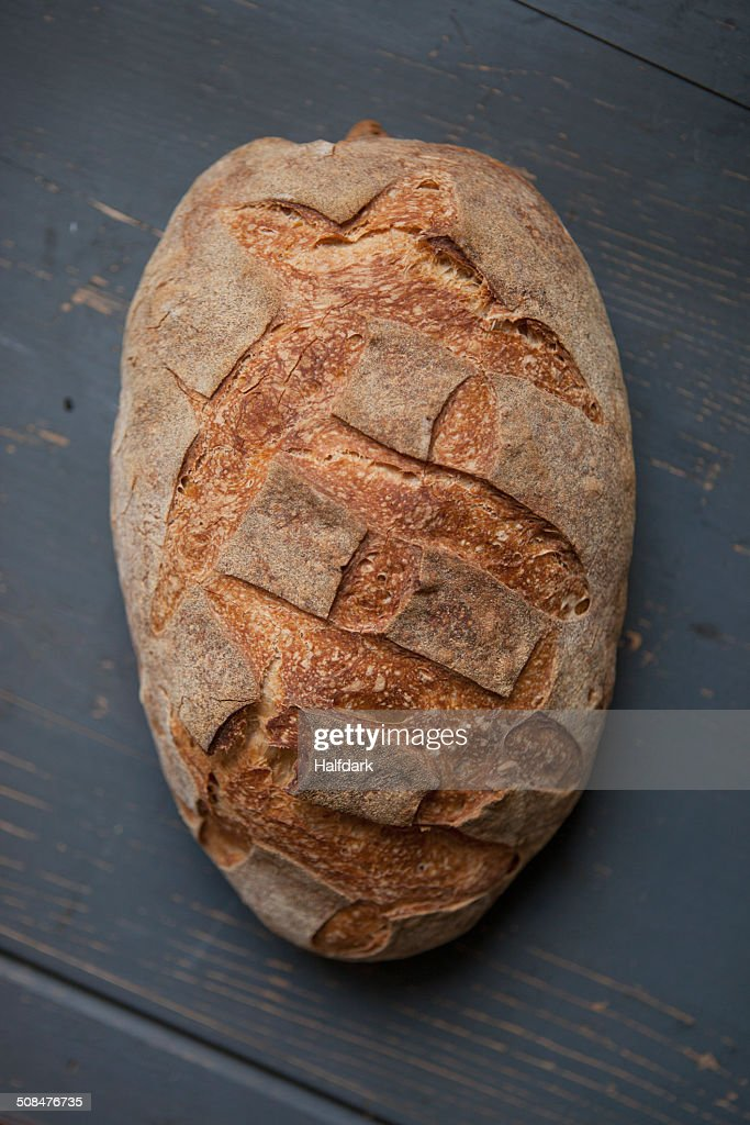 High angle view of bread loaf on table : Stock Photo
