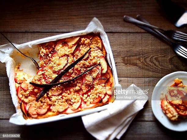 High Angle View Of Bread Pudding On Wooden Table