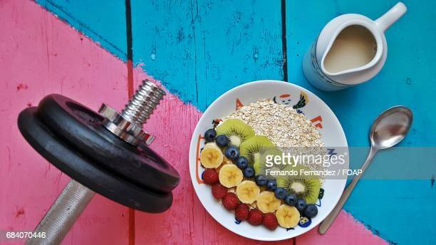 High angle view of breakfast with dumbbell