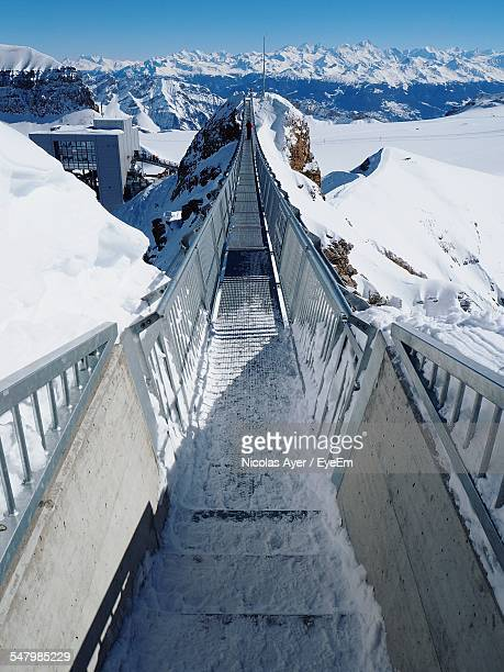 High Angle View Of Bridge At Snowcapped Mountain