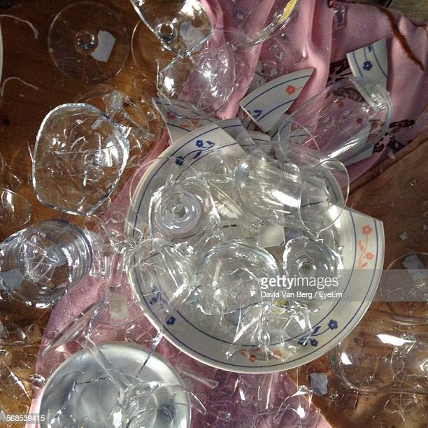 High Angle View Of Broken Glasses On Table