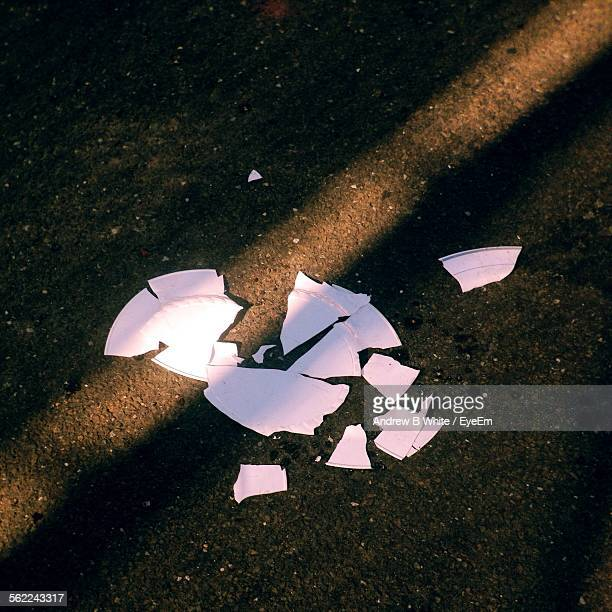 High Angle View Of Broken Plate On Street