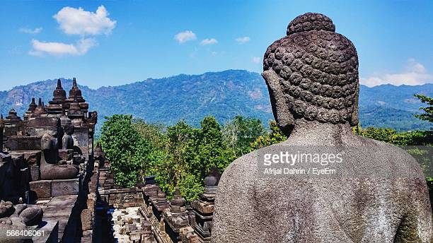 High Angle View Of Buddha Statue At Borobudur Temple Against Mountain