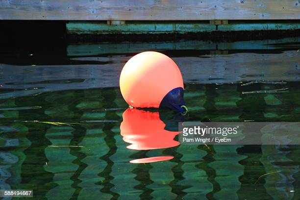 High Angle View Of Buoy Floating On Water