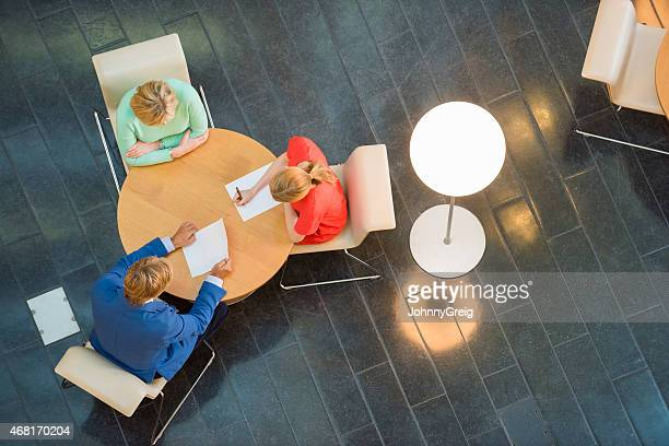 High angle view of business people in meeting