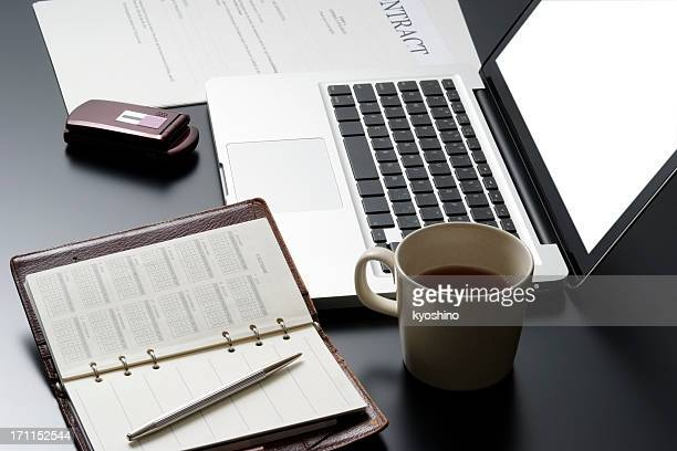 High angle view of business tools on black desk