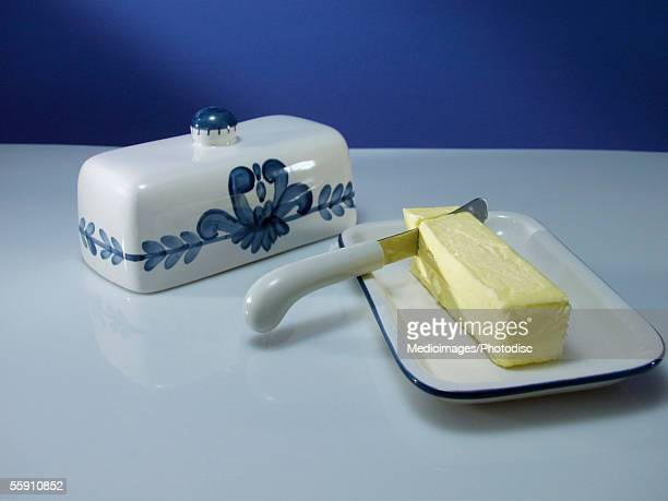 High angle view of butter in a butterdish with a knife