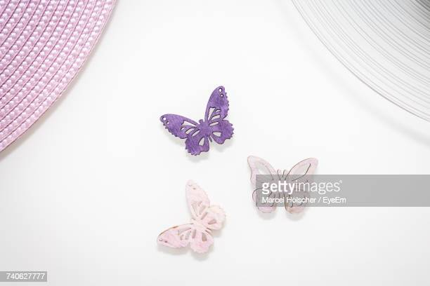 High Angle View Of Butterfly Shaped Decorations On White Background