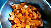 High Angle View Of Butternut Squash Slices In Metal Bowl