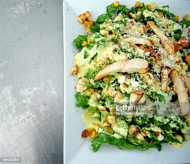 High Angle View Of Caesar Salad Served In Plate On Table