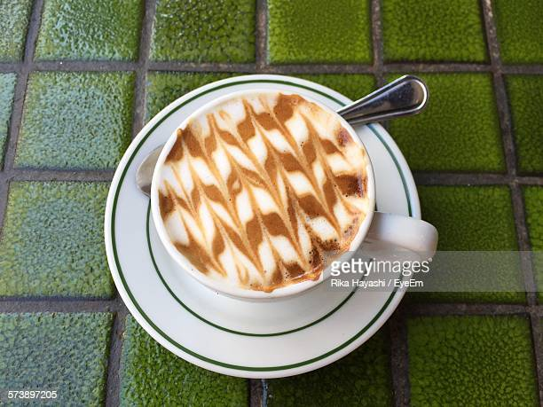 High Angle View Of Cafe Macchiato On Table