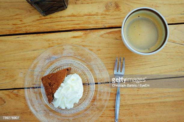 High Angle View Of Cake And Coffee Cup On Table