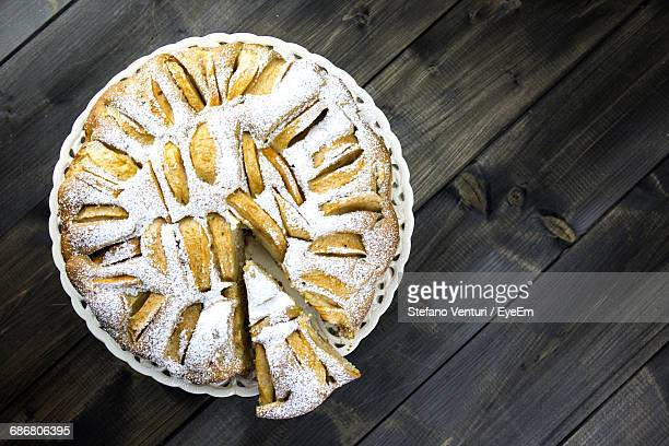 High Angle View Of Cake On Plate On Wooden Table, Cu