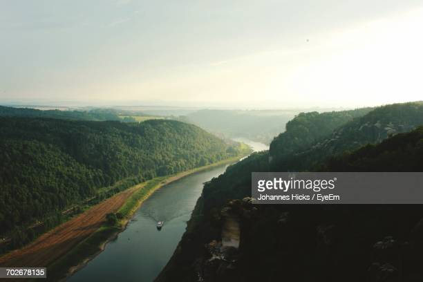 High Angle View Of Calm River Against Mountain Range