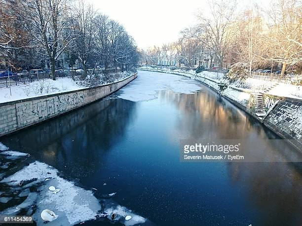High Angle View Of Canal Amidst Snow Covered Field