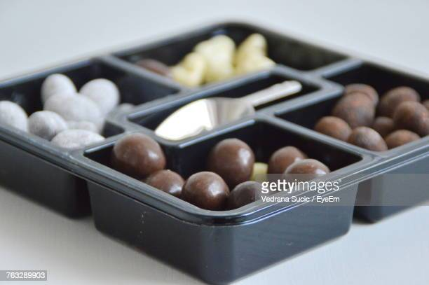 High Angle View Of Candies In Container