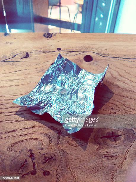 High Angle View Of Candy Wrapper On Wooden Table