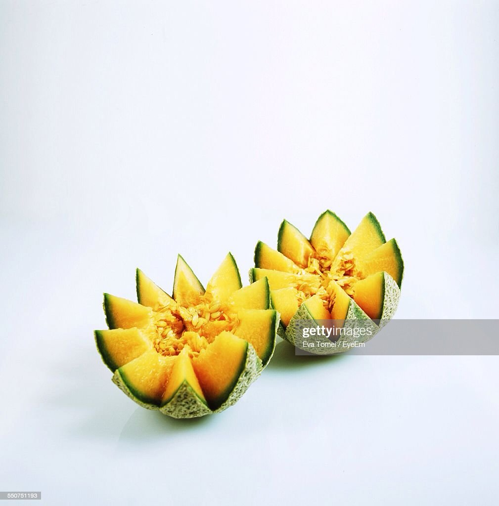 High Angle View Of Cantaloupes Against White Background