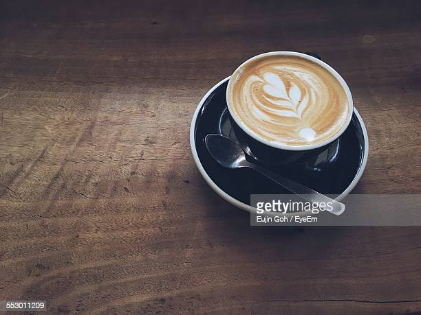 High Angle View Of Cappuccino On Wooden Table