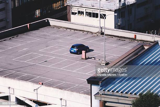 High Angle View Of Car Parked In Parking Lot Of Building Terrace