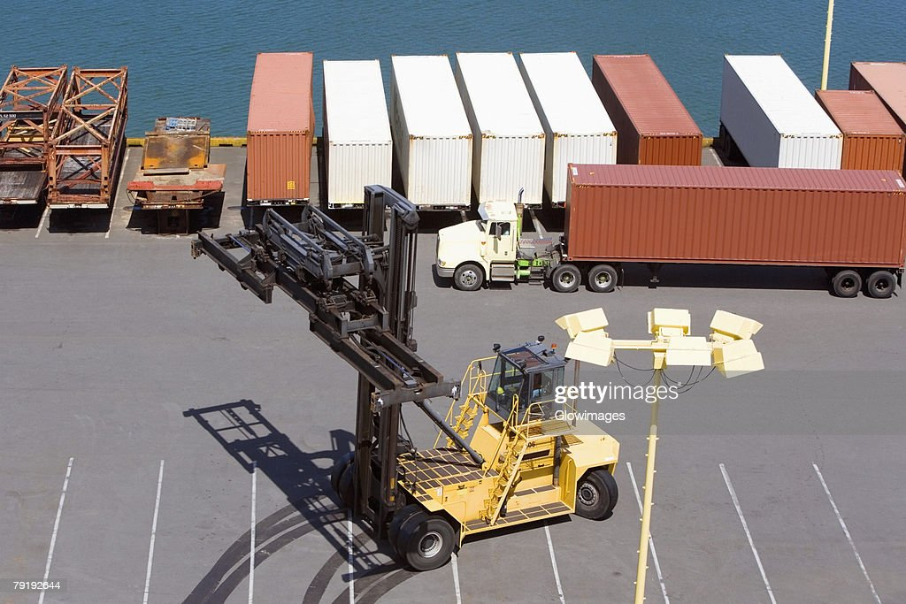 High angle view of cargo containers and a crane at a commercial dock : Foto de stock