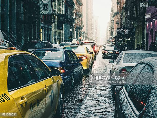 High Angle View Of Cars On Street Amidst Buildings In Rainy Season