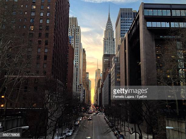 High Angle View Of Cars On Street By Chrysler Building And Towers In City