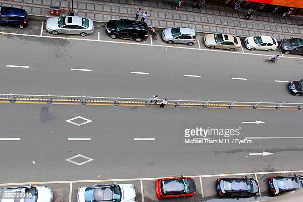 High Angle View Of Cars Parked On Road