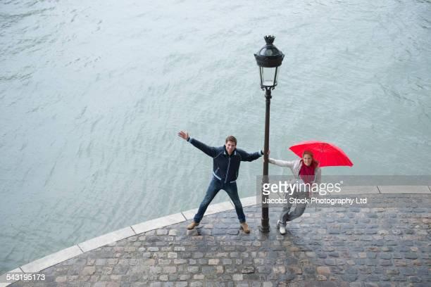 High angle view of Caucasian couple posing near streetlamp