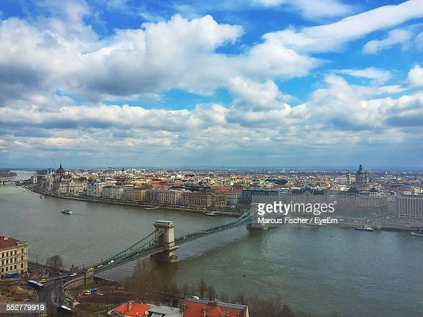 High Angle View Of Chain Bridge And Cityscape Against Blue Sky