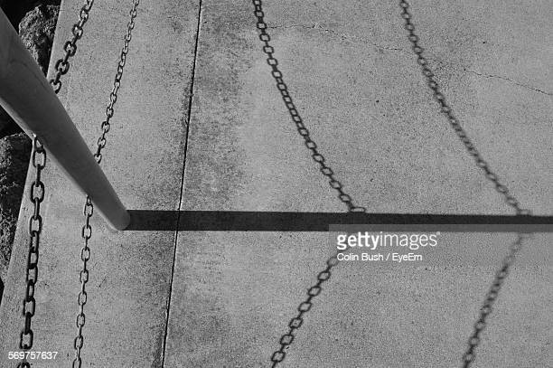High Angle View Of Chain Fence Shadow