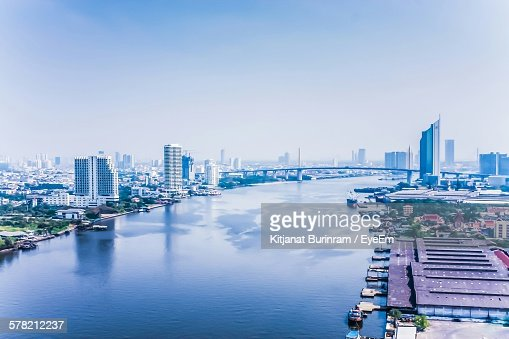 High Angle View Of Chao Phraya River Amidst Buildings In City Against Sky