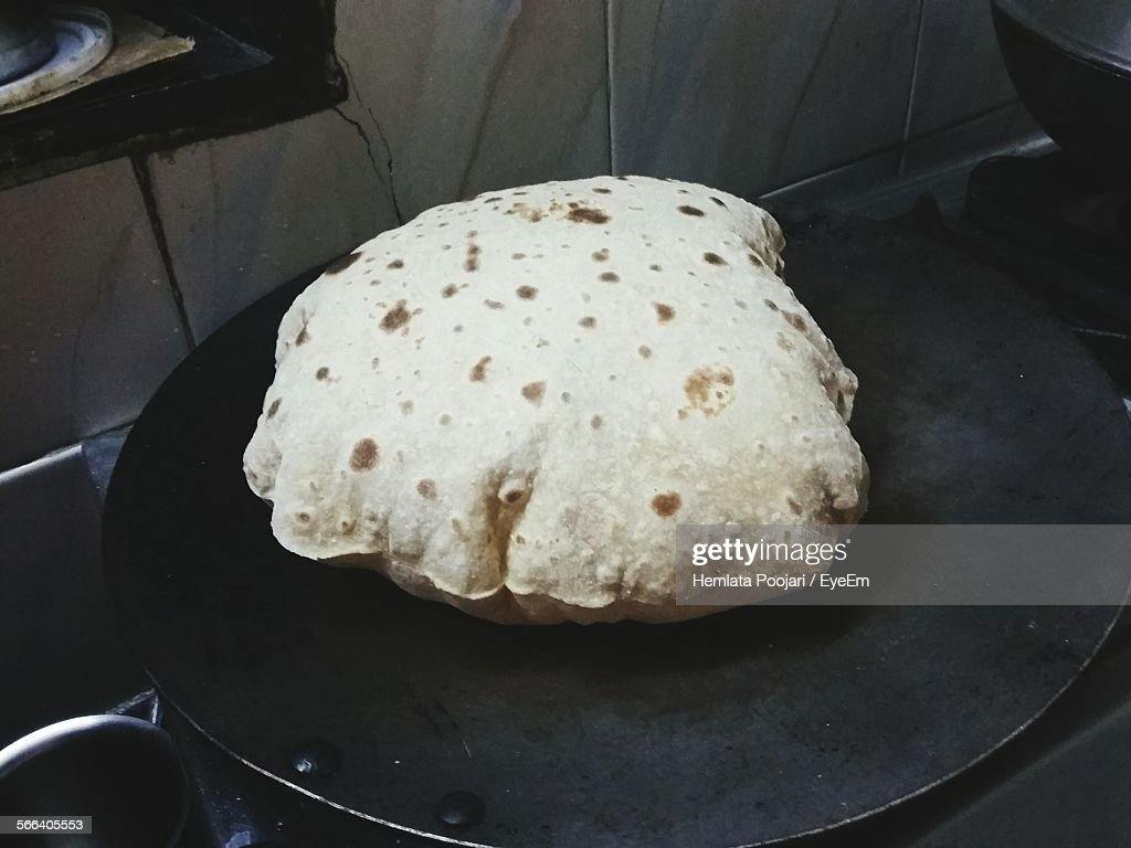 High Angle View Of Chapatti On Cooking Pan
