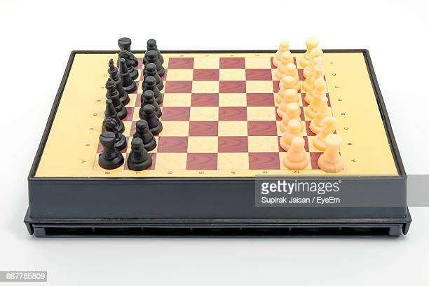 High Angle View Of Chess Board And Pieces On White Background