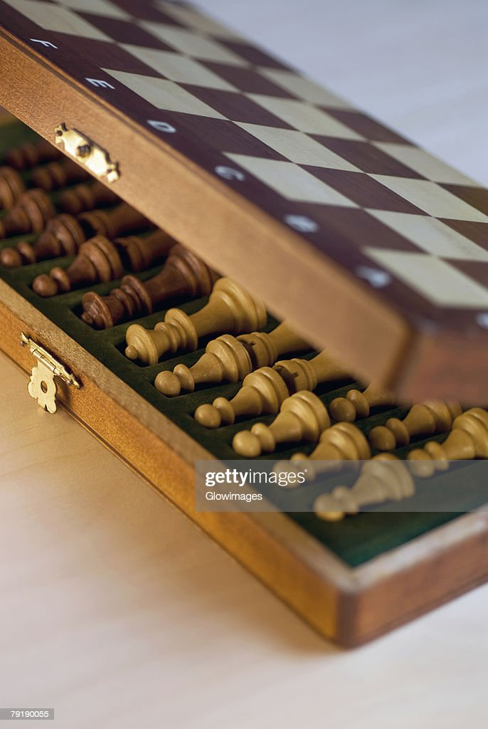 High angle view of chess pieces in a wooden box : Stock Photo