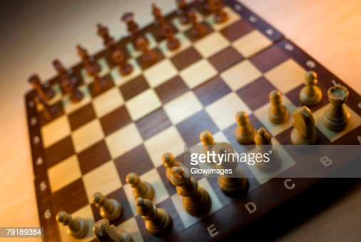 High angle view of chess pieces on a chessboard : Foto de stock