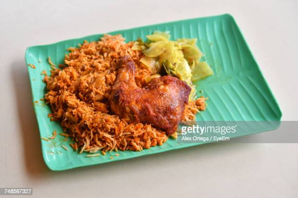 High Angle View Of Chicken Biryani In Plate Over White Background