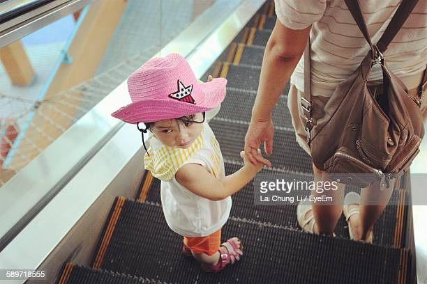 High Angle View Of Child With Mother On Escalator