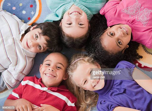 High angle view of children lying on floor