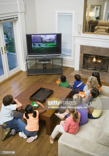 High angle view of children watching television
