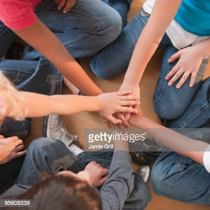 High angle view of children's hands stacked : Stock-Foto
