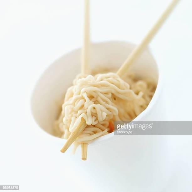 high angle view of chinese noodles in a bowl with a pair of chopsticks