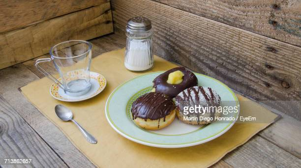 High Angle View Of Chocolate Donuts In Plate On Table