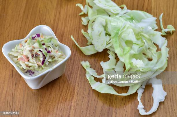 High Angle View Of Chopped Cabbage With Salad On Table
